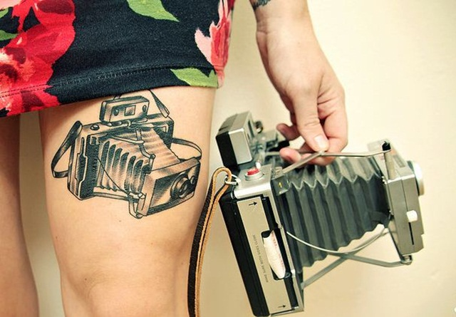 Polaroid Thigh tattoo
