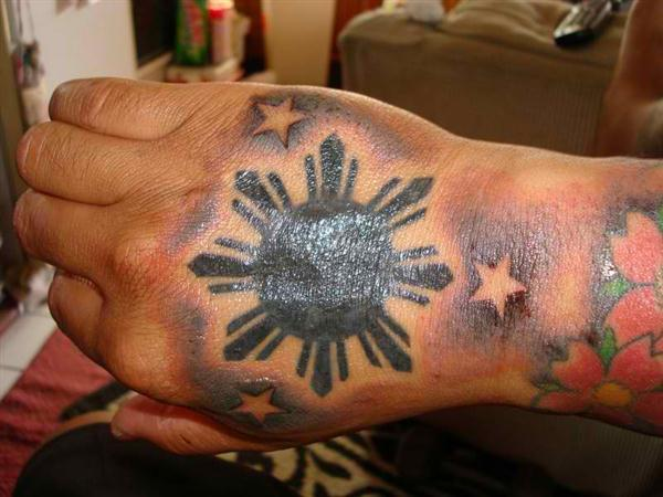 star and sun tattoo