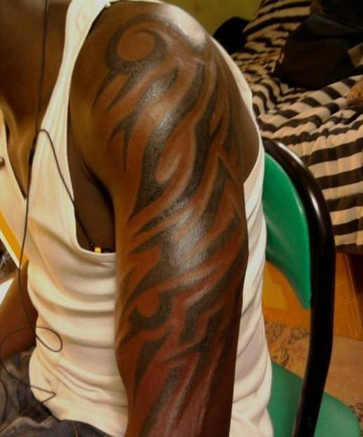 Arm tribal tattoo
