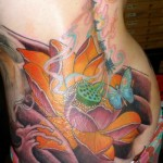 Big flower and butterfly tattoo