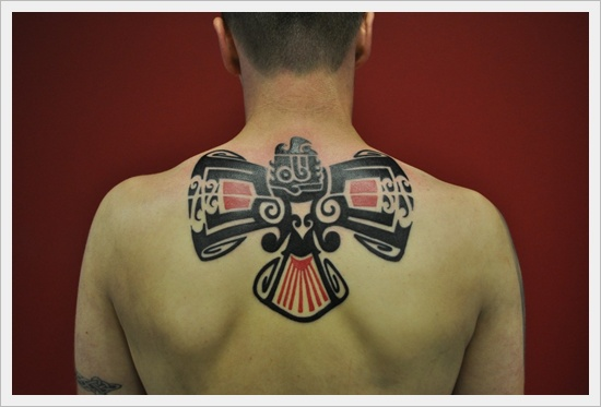 Upper back colorful tribal tattoo