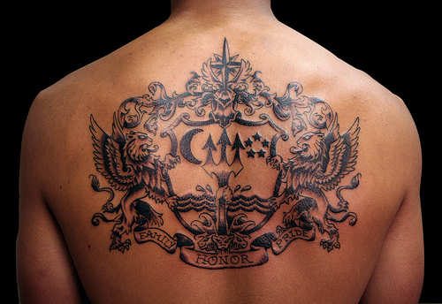 Wording upper back tattoo