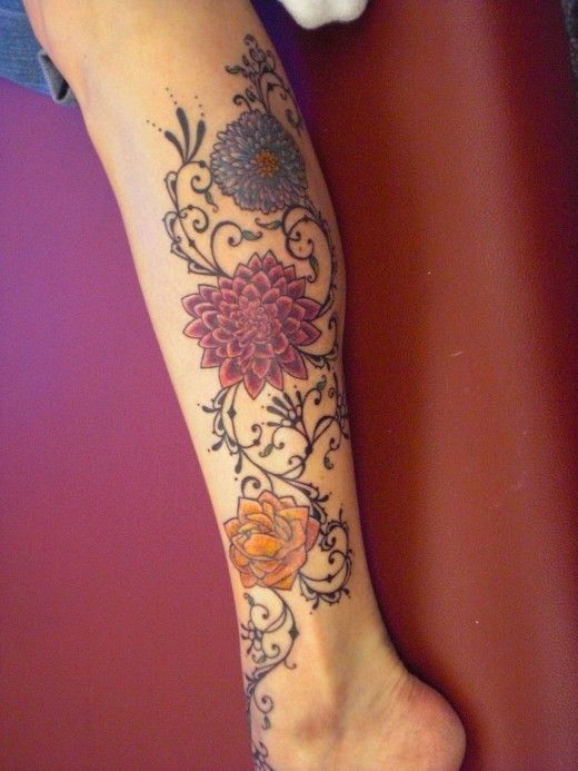 Colorful dahlia tattoo on calf