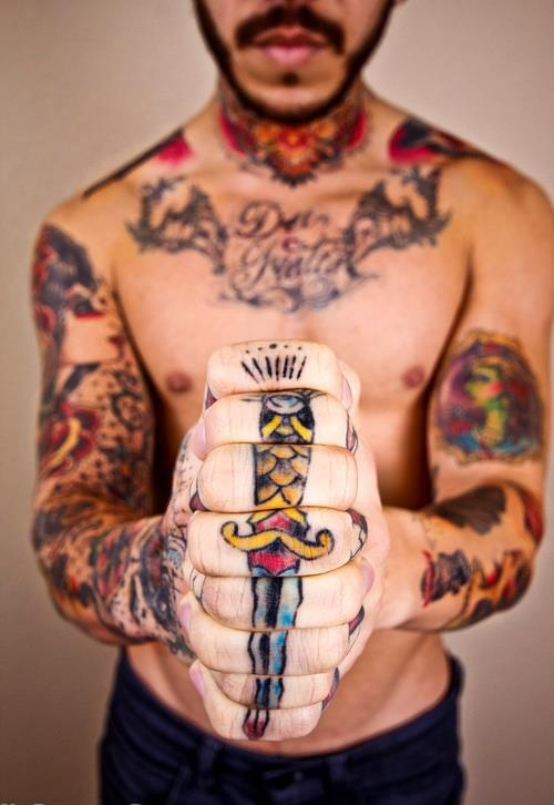 Colorful knuckle tattoo