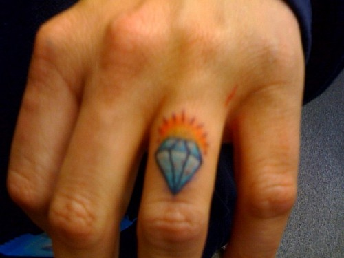 Diamond knuckle tattoo