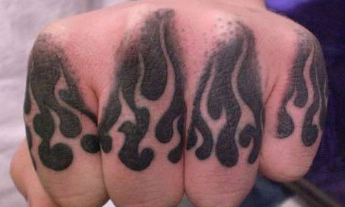 Flames knuckles tattoo