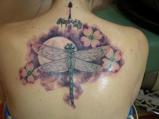 Flower and dragonfly tattoo