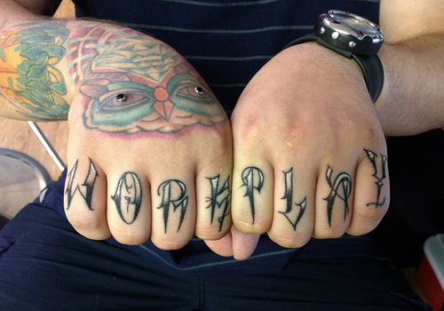 Meaningful knuckle tattoo