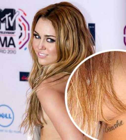 Miley Cyrus Breathe tattoo under the left breast