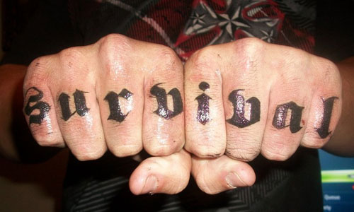 Thick black Survival knuckle tattoo