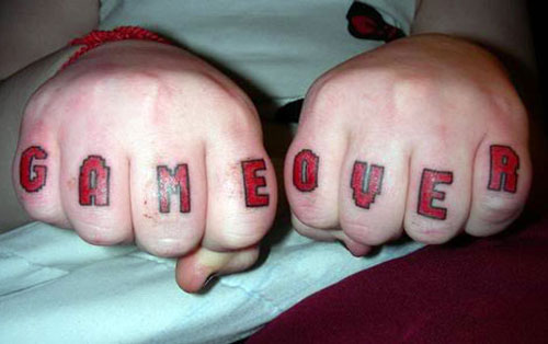 Video game knuckle tattoo