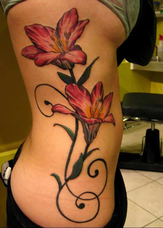 Beautiful lily tattoos with green leaves