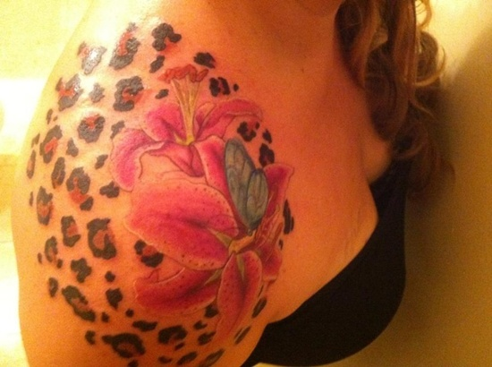 Unique lily tattoo with butterfly