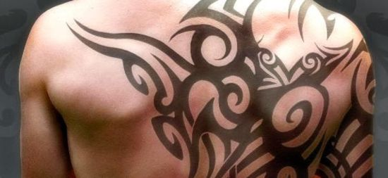 Awesome tribal back tattoo for men