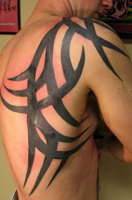 Cool tribal back and shoulder tattoo for men
