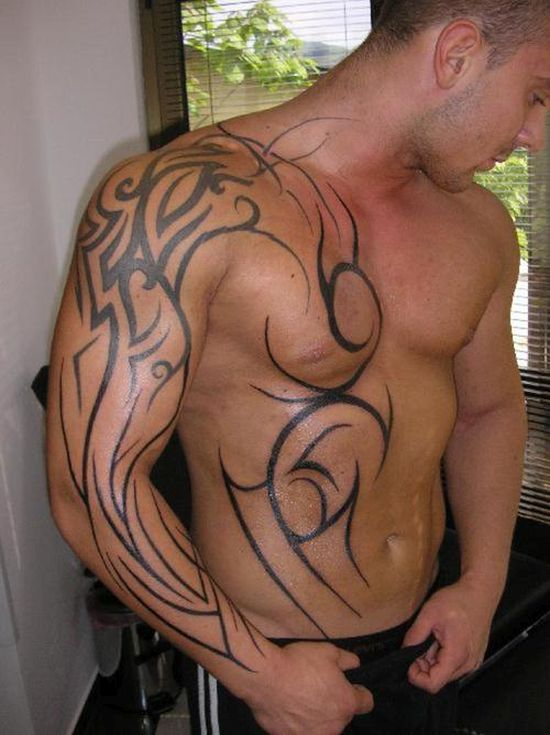 Fabulous tribal arm and chest tattoo for men