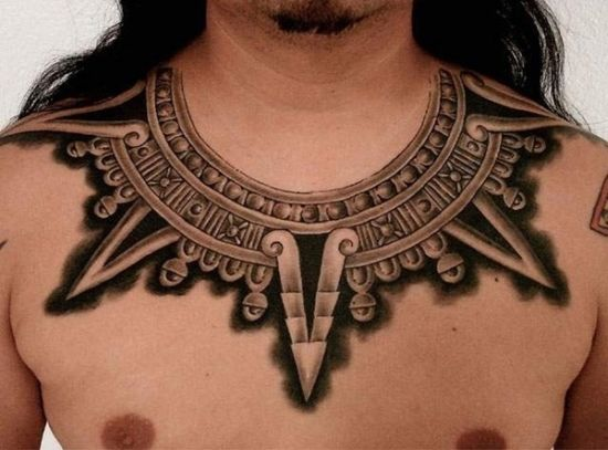 Mindblowing tribal chest tattoo for men