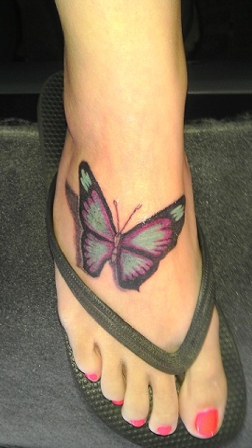 radiant butterfly tattoo on foot amazing tattoo ideas. Black Bedroom Furniture Sets. Home Design Ideas