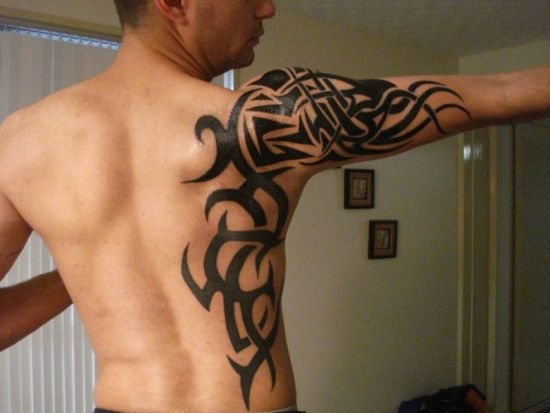 Side back and arm tribal tattoo design for men