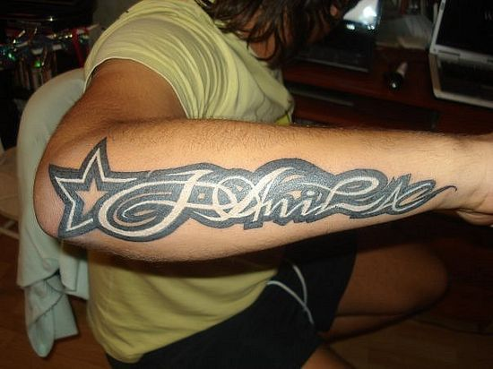 Cool arm letter tattoo
