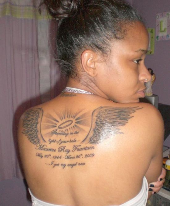Message angel wing tattoo