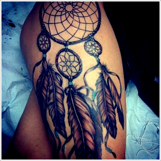 Dreamcatcher tattoos on thigh