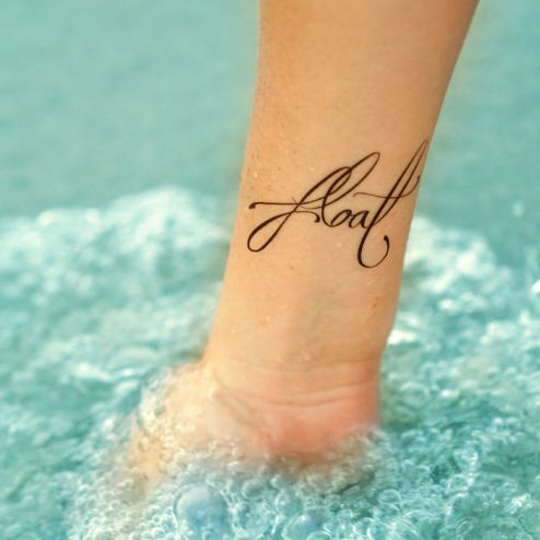 """Float"" Word Arm Tattoo"