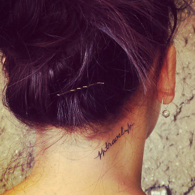 """Travel"" Word Nape Tattoo"