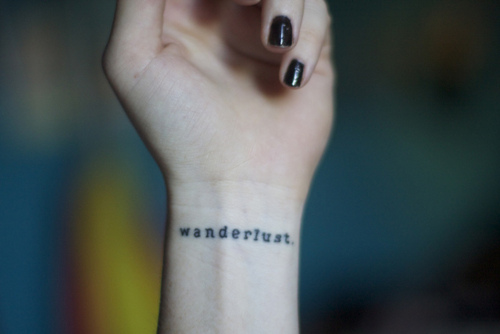 """Wanderlust"" Word Wrist Tattoo"