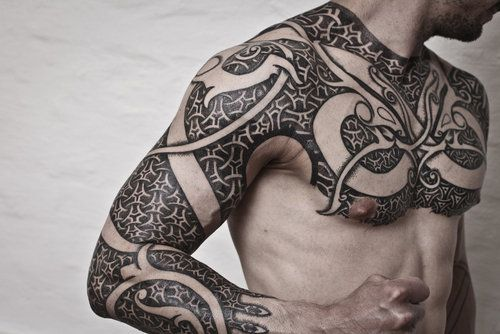 38a03a837a6df Tribal Chest To Arm Tattoo   Amazing Tattoo Ideas