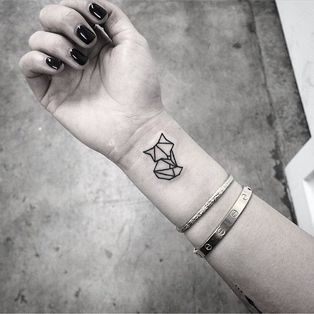 Subtle Geometric Fox Wrist Tattoo