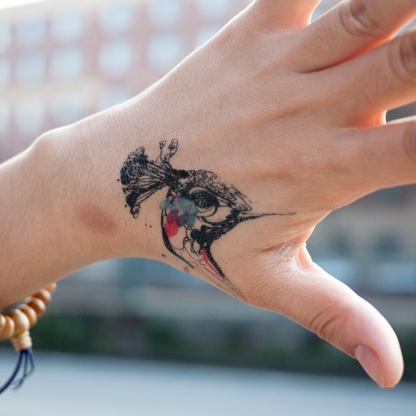 Bird Hand Tattoo