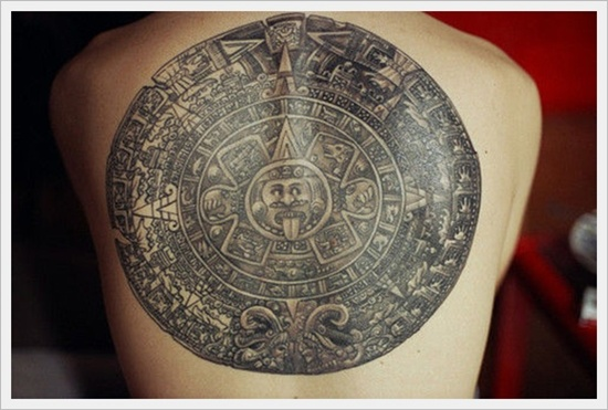 Circular Tribal Emblem Back Tattoo