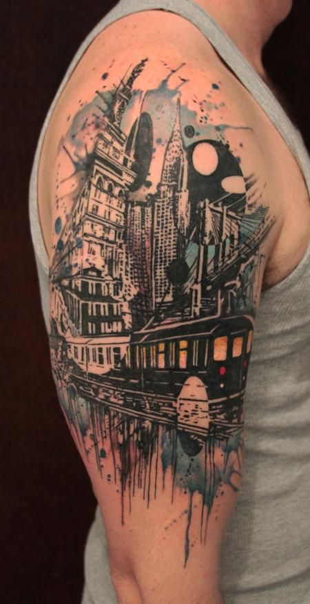 Cityscape Watercolor Arm Tattoo