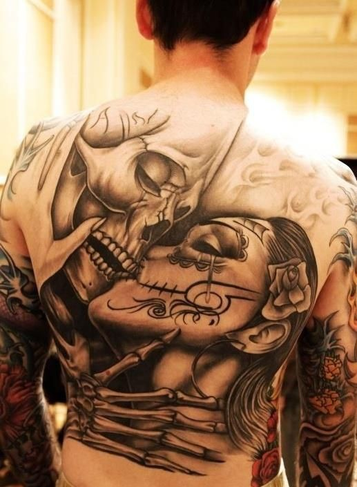 Couple Skulls Back Tattoo
