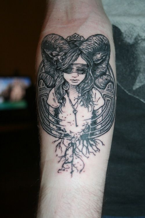 Girl With Ram Horns Forearm Tattoo