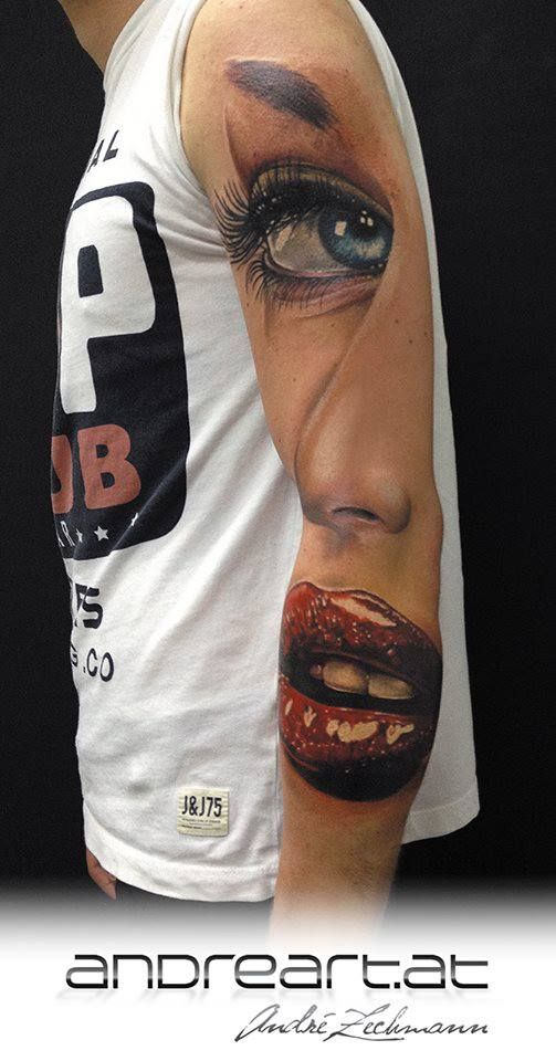 Visage Arm Tattoo