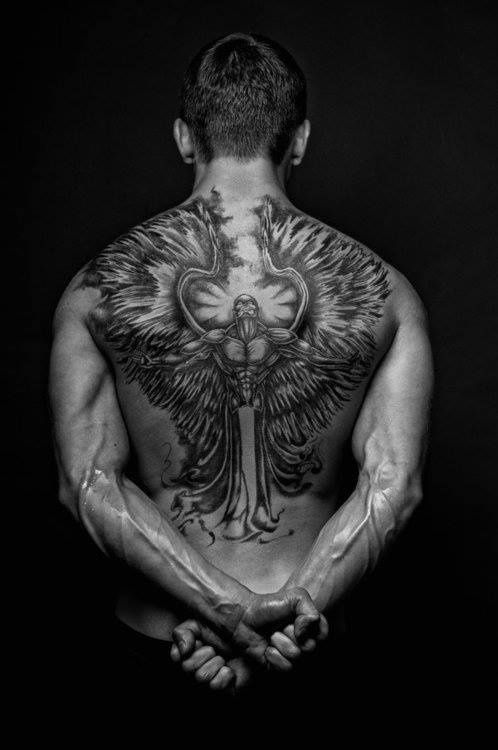 Winged Man Back Tattoo