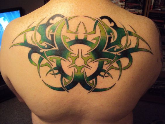 Cool Tribal Upper Back Tattoo