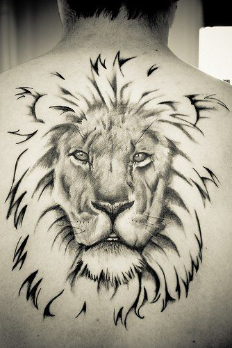 Lion Upper Back Tattoo