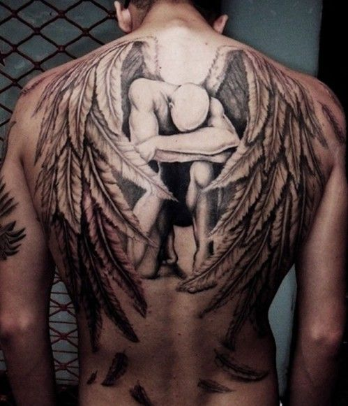 Winged Man Upper Back Tattoo