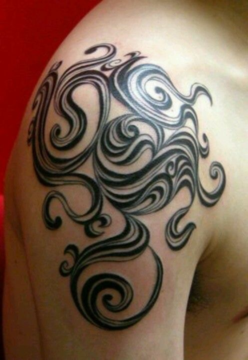 Ornamental Tribal Arm Tattoo