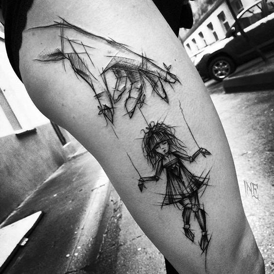 Sketchy Puppeteer Thigh Tattoo