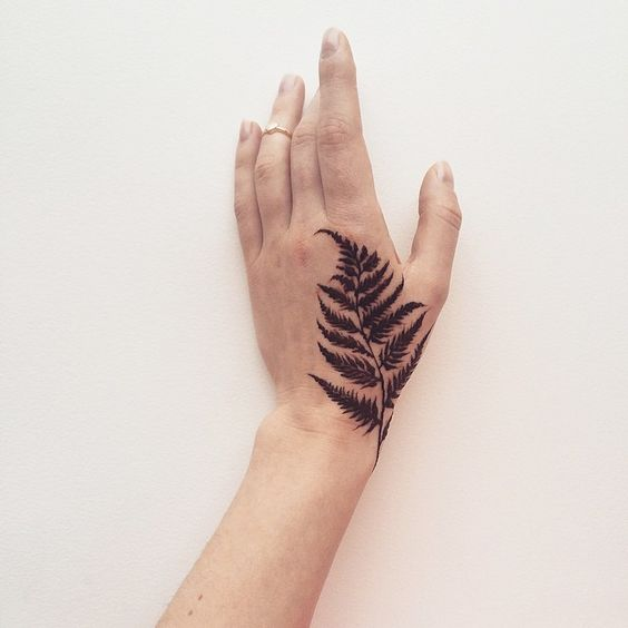 Blackwork Fern Hand Tattoo