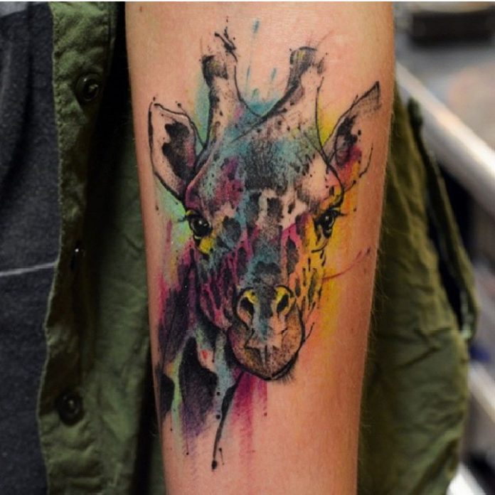 Watercolor Giraffe Head Arm Tattoo