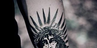 Solid Black Jesus Forearm Tattoo