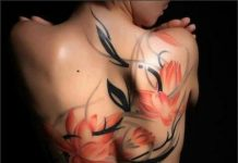 Defined Orange Watercolor Flower with Black Vines Back Tattoo