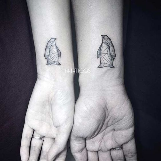 Geometric Penguins Wrist Tattoos