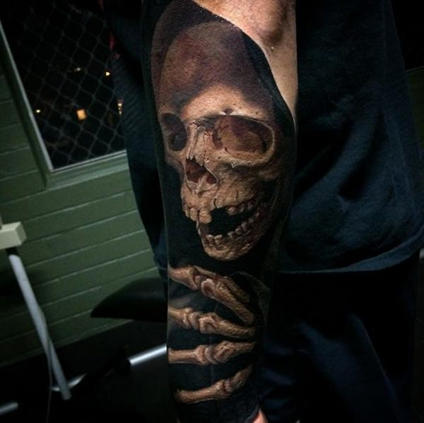 Realistic Skull Arm Tattoo