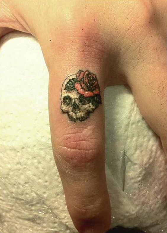 Little Skull with Large Red Rose Finger Tattoo